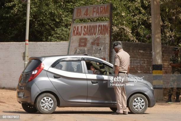 Police team stopping and checking vehicles at Fathehpur Beri Dera Mod as demolition drive was carried at Asola village in Chhattarpur on March 14...