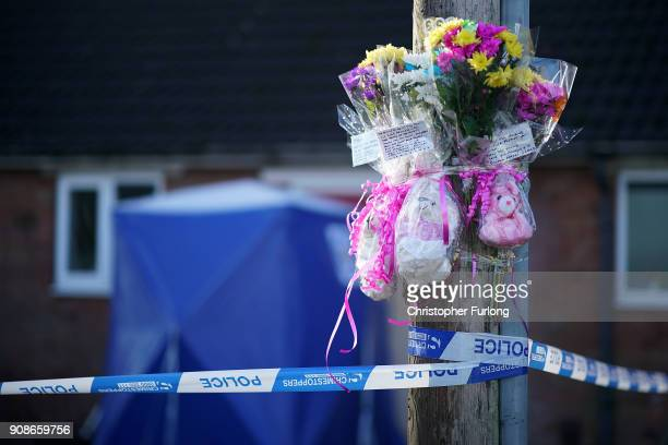 A police tent and floral tributes stand outside a home in Valley View Brownhills Walsall where Mylee Billingham aged eight was stabbed and later died...