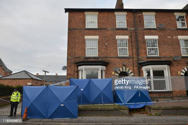 Police tents in Woverhampton Road Stafford as forensic officers continue their search at the property linked to London Bridge terrorist attacker...