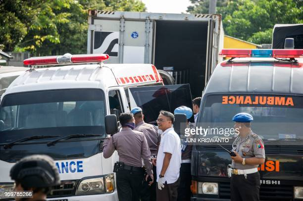 Police transfer the bodies of individuals involved in the Surabaya suicide bombings to ambulances so they can be buried in Surabaya East Java...