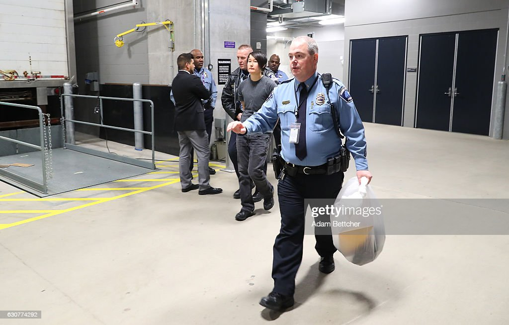 Police transport a protester after the Minnesota Vikings and Chicago Bears football game on January 1, 2017 at US Bank Stadium in Minneapolis, Minnesota. The protesters unfurled a banner in opposition to the Dakota Access Pipeline in the second quarter of the game.