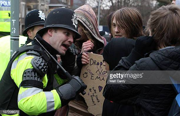 Police tried to hold back students who were trying to occupy a Bristol University building as they took part in a protest over the Government's...