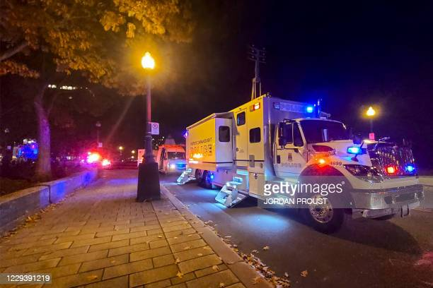 Police truck is parked near the National Assembly of Quebec, in Quebec City, early on November 1 after two people were killed and five wounded by a...