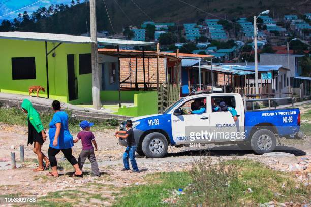 A police truck patrols a poor area in Comayaguela Honduras on October 22 2018 Honduran migrants taking part in a caravan heading to the US told AFP...