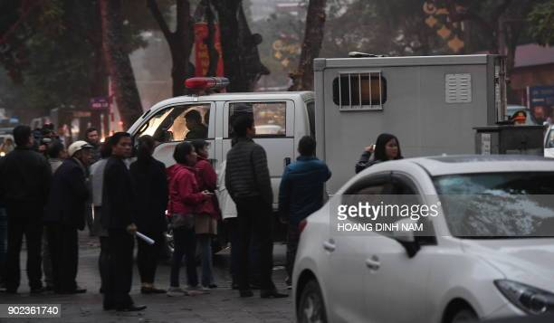 A police truck transporting defendants arrives at the Hanoi People's Courthouse prior to the beginning of the trial of Trinh Xuan Thanh a former oil...