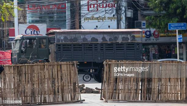 Police truck transporting police officers drove past during a demonstration against the military coup. Myanmar police attacked protesters with rubber...