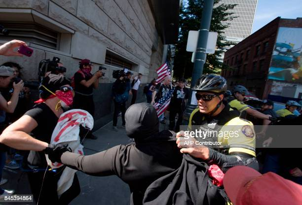 Police try to contain Antifa protesters from approaching members of the Patriot Prayer Movement during a protest to oppose the right wing group The...