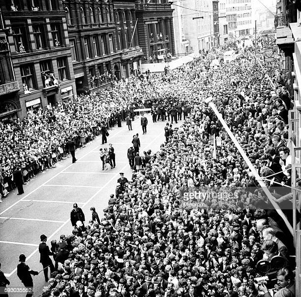 Police try to control fans in the streets of Liverpool before the premiere of The Beatles film 'A Hard Day's Night' 10th July 1964
