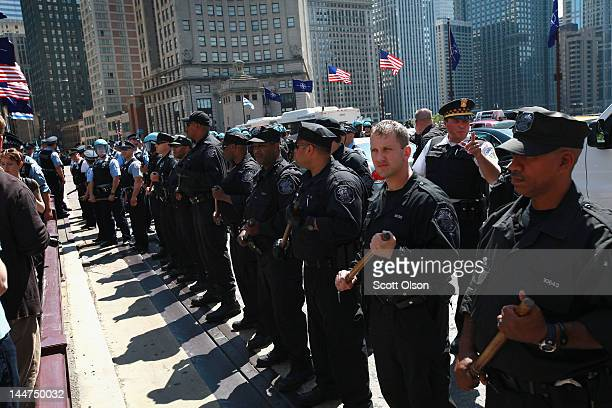 Police try to control protestors on the Michigan Avenue bridge during an impromptu demonstration that weaved its way through downtown on May 18 2012...
