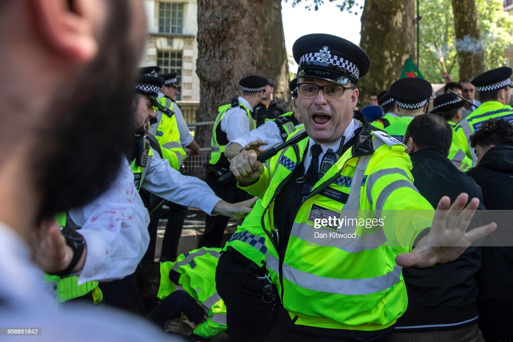 Police try to control the crowd as Pro and anti-Erdogan protesters demonstrate outside Downing Street as Turkish President Recep Tayyip Erdogan meets the Prime Minister, on May 15, 2018 in London, England. Turkish President Mr Erdogan is in the UK for a three-day visit, which includes a closing lecture at the Tatlidil Forum in Oxford, an audience with The Queen and talks with British Prime Minister Theresa May.