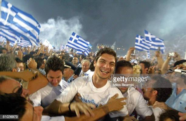 Police try to create a path for Greek national player Angelos Charisteas and other players arriving for a victory fiesta on July 5 2004 in a packed...