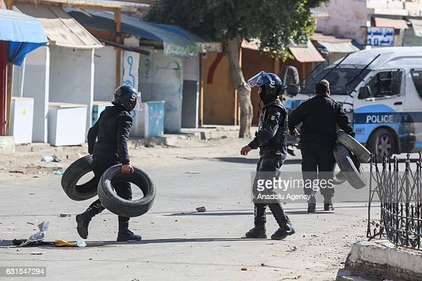 Police try to disperse the protesters demanding giving social rights to citizens and resolution of the crisis at Ras Jadir border crossing between...