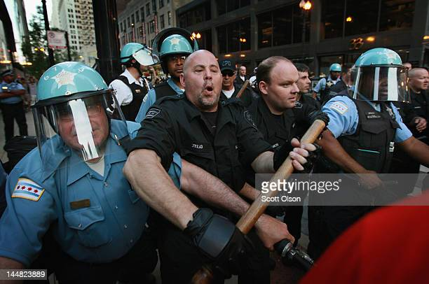 Police try to keep demonstrators from breaking through their lines durijng a march through the downtown streets on May 19 2012 in Chicago Illinois...