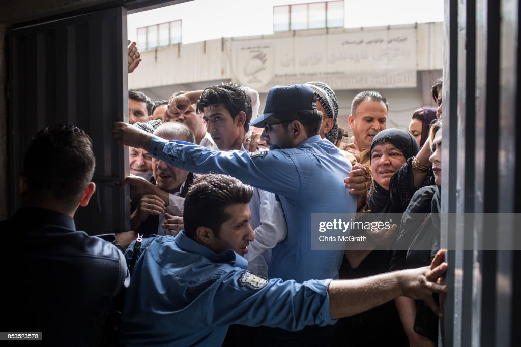 Police try to keep people from forcing their way into a voting station on September 25, 2017 in Erbil, Iraq. Despite strong objection from neighboring countries and the Iraqi government. Some five million Kurds took to the polls today across three provinces in the historic independence referendum.