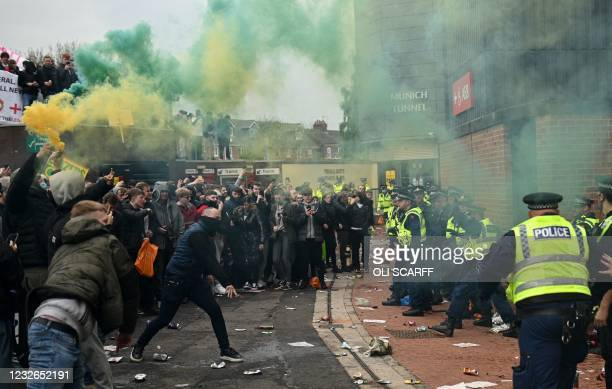 Police try to move people away from the stadium after a supporter's protest against Manchester United's owners, outside English Premier League club...