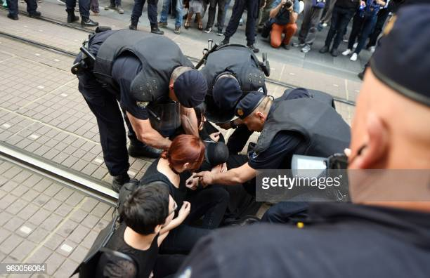 Police try to stop a blockade of women rights activists in downtown Zagreb on May 19 in a bid to block participants of Croatia's third annual...
