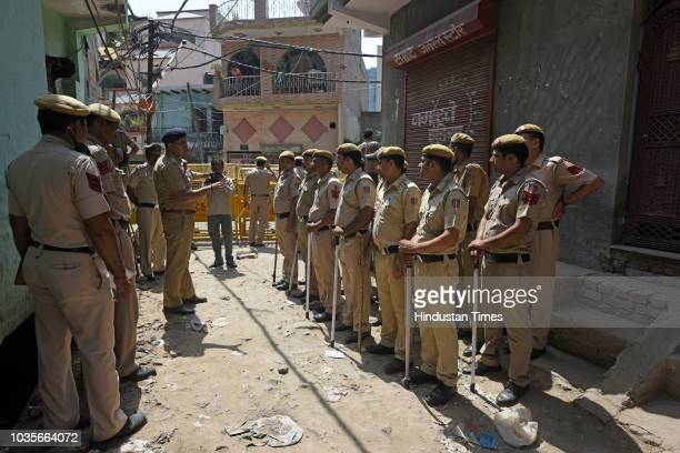 Police try to stop BJP President Manoj Tiwari as he attempts to break the seal of a property sealed by MCD in Gokulpuri area on September 18 2018 in...