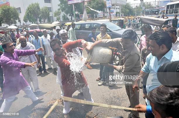 Police trying extinguish an effigy of Prime Minister Narendra Modi burned by Congress workers during protest against Central Government over the...