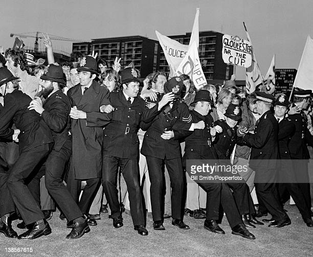 Police trying to conrtol the jubilant Gloucestershire supporters after the Gillette Cup Final between Gloucestershire and Sussex at Lord's cricket...