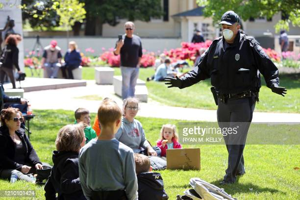 Police urge protesters to spread out during a rally against stayathome orders related to the coronavirus pandemic at Capitol Square in Richmond...
