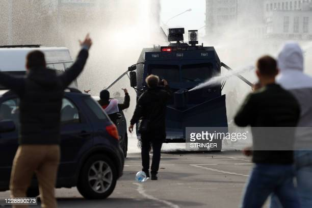 Police use a water cannon truck during a rally demanding to free jailed activists of the opposition in Minsk on October 4 2020 Belarusian police on...
