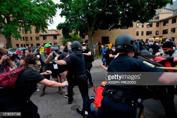 Police use batons as they clash with protesters outside the District Four Police station during a Black Lives Matter protest against police brutality...