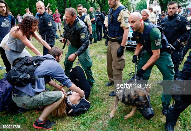 Police use dogs to clear a sitin protest of vocational school students against the deportation of a 20yearold Afghan fellow student in Nuremberg...