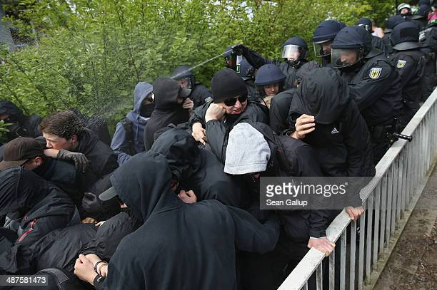 Police use pepper spray against leftist protesters who were trying to block access to a pedestrian bridge at the Lichtenhagen SBahn commuter train...