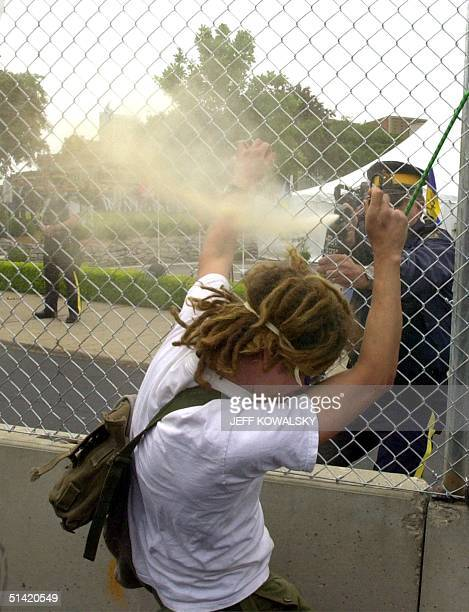 Police use pepper spray on a protester at a rally outside of the the Cleary International Center in Windsor Canada the location of the Organization...