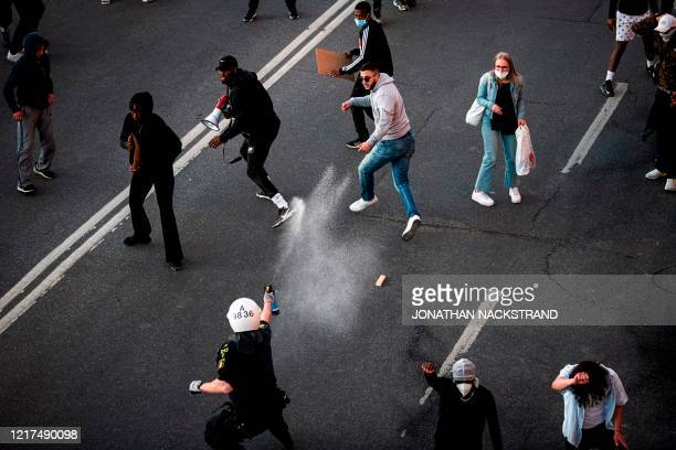 Police use pepper spray on protesters during a Black Lives Matter demonstration in Stockholm Sweden on June 3 in solidarity with protests raging...