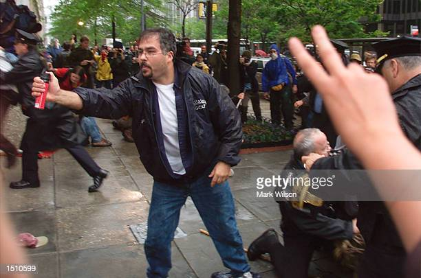 Police use pepper spray to keep protesters back while they make arrests April 17 2000 in Washington DC Hundreds of people participated in the...