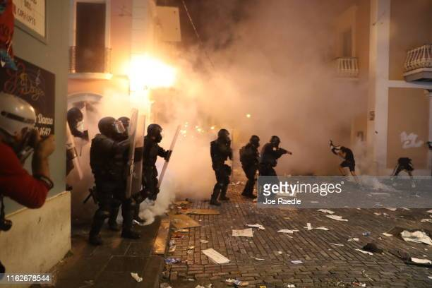 Police use tear gas against protesterds demonstrating against Ricardo Rossello the governor of Puerto Rico on July 17 2019 in Old San Juan Puerto...
