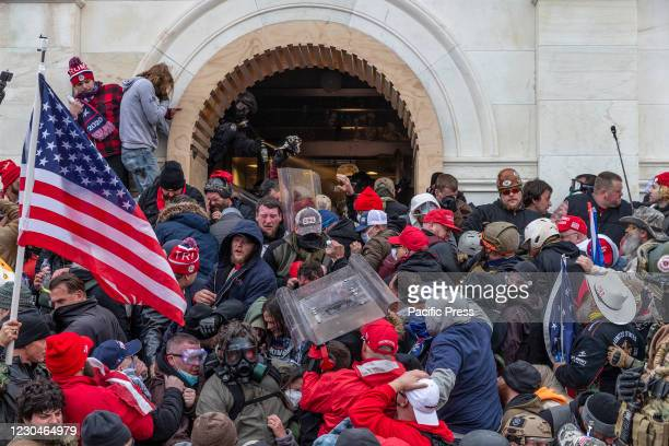 Police use tear gas around Capitol building where pro-Trump supporters riot and breached the Capitol. Rioters broke windows and breached the Capitol...