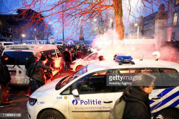 Police use tear gas to disperse environmentalists during a protest against briefing meeting on World Economic Forum to be held in Brussels Belgium on...