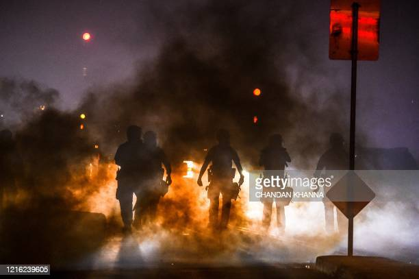TOPSHOT Police use tear gas to disperse protesters during a demonstration in Minneapolis Minnesota on May 29 over the death of George Floyd a black...