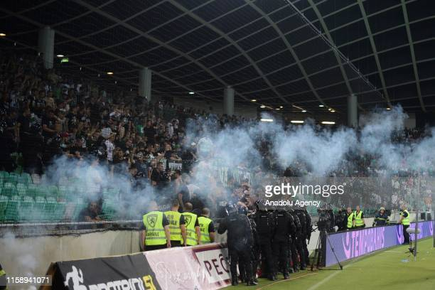 Police use tear gas to disperse soccer fans after a quarrel during UEFA Europa League second qualifying round soccer match between Yeni Malatyaspor...