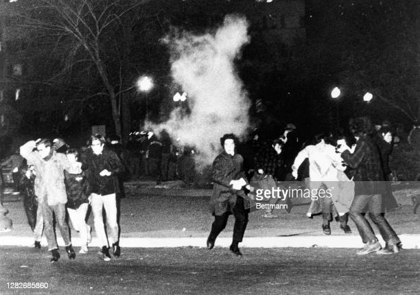 Police use tear gas to hold back a crowd of war protestors as they tried to march to the Vietnamese Embassy following a rally. It was the first...