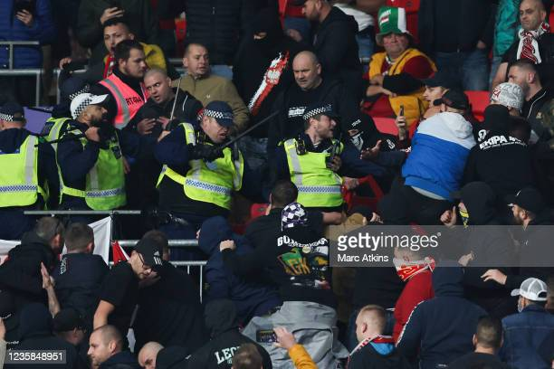 Police use their batons as they are attacked by Hungary fans during the 2022 FIFA World Cup Qualifier match between England and Hungary at Wembley...