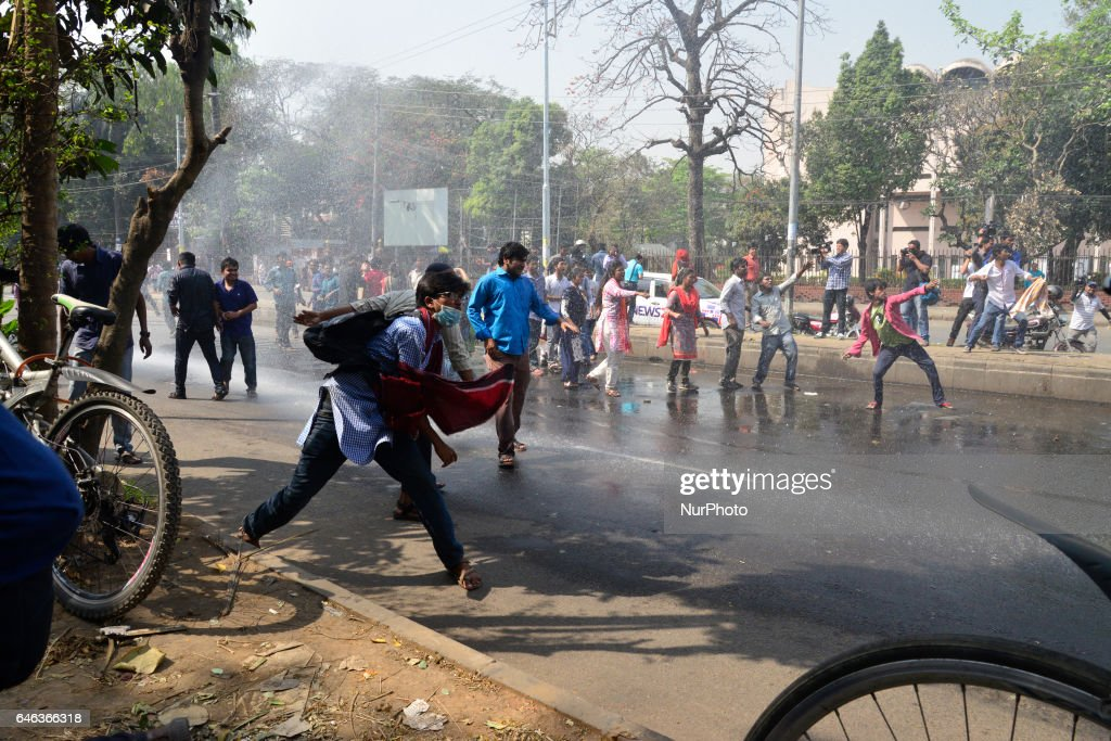 "Police use water cannon on demonstrators during the shutdown against gas tariff hike in Dhaka, Bangladesh on February 28, 2017. Activists from the ""Progressive Student Alliance"" , the student wing of the Communist Party of Bangladesh (CPB) and the Bangladesher Samajtantrik Dal (BSD) along a coalition of left-leaning political party organized the strike after the Bangladesh Energy Regulatory Commission announce increase of gas price. During the protest, police use tear gas canisters and water cannon to disapear the protestors from the streets. At least 10 demonstrators have been detained on Tuesday from Dhaka's Shahbagh."