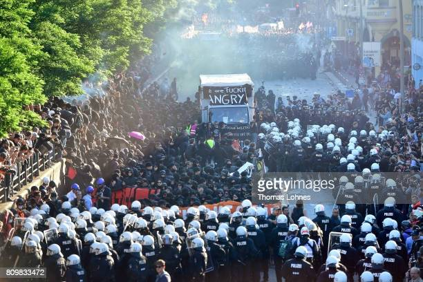 Police use water cannons and peper spray against demonstrators at Hamburg harbor attending the âWelcome to Hell❠antiG20 protest march on July 6...
