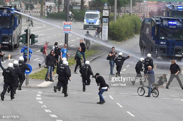 Police use water cannons as protesters gather to participate in an anti-G20 march on July 7, 2017 in Hamburg, Germany. Authorities are braced for...
