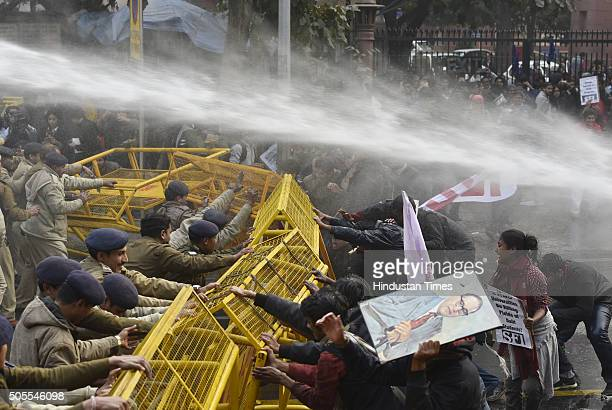 Police use water cannons on the activists of various student organisations including KYS, SFI, AISA, SDPI and BAPSA during a protest outside HRD...
