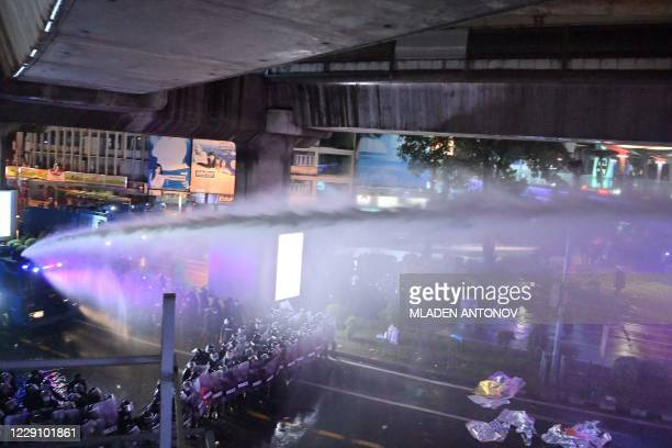 Police use water cannons to disperse pro-democracy protesters during an anti-government rally in Bangkok on October 16, 2020.