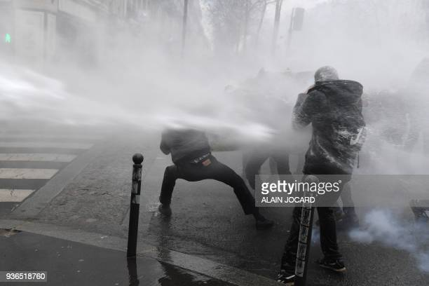 TOPSHOT Police use water canon against demonstrators during a protest against French government's string of reforms on March 22 2018 in Paris Seven...