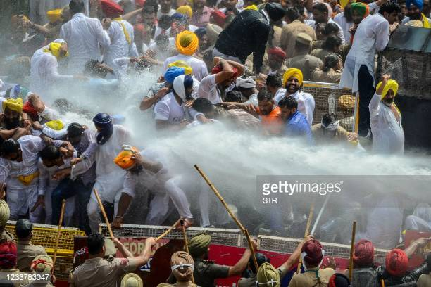Police use water canon to disperse the protestors comprising of supporters and activists of the Aam Aadmi Party who took part in a demonstration...