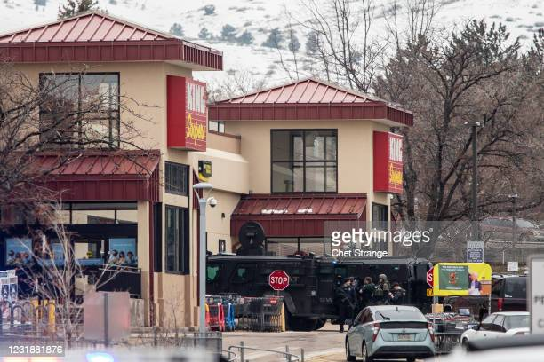 Police used armored vehicles to smash windows and walls to gain access as a gunman opened fire at a King Sooper's grocery store on March 22, 2021 in...