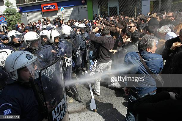 Police uses pepper spray to dispearse protestors at the he start of a military parade marking the 191th anniversary of Greece's war of independence...