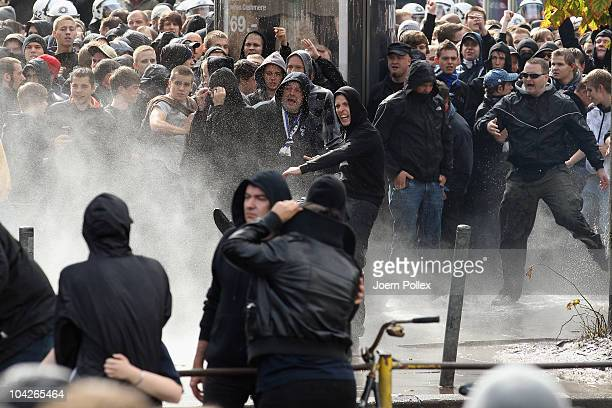 Police uses water canons against supporter of Hamburger SV on their way to the stadium prior to the Bundesliga match between FC St Pauli and...