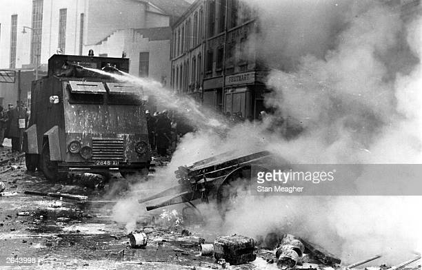Police using water cannons on the streets of Derry during civil rights demonstrations in the Bogside.