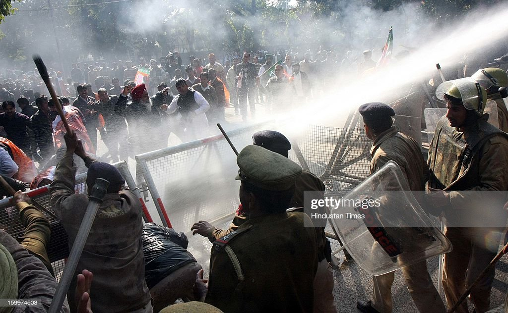 Police using water canon on BJP workers who are protesting against Home minister Sushilkumar Shinde's Hindu Terror remark on January 24, 2012 in Chandigarh, India. Home minister Shinde has alleged that BJP and RSS were behind Hindu terror during recently held Congress Conclave at Jaipur.